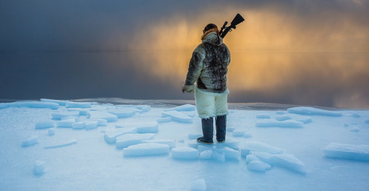 I watched as the sun dipped below the horizon, and the molten gold of sunset saturated the twilight. Just as his ancestors have done for centuries before him, Naimanngitsoq Kristiansen waits patiently for harp seal or walrus at the ice edge.    Greenland