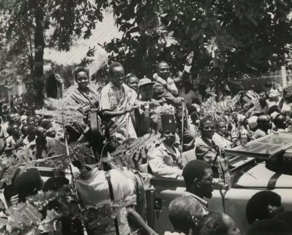 Tanzania's first president, Julius Nyerere (center) saw reduced fertility as key to Tanzania's future as a sovereign nation. UK National Archives , CC BY