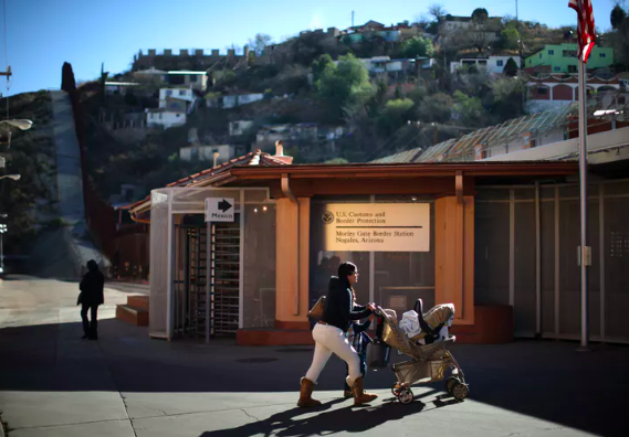 A woman walks toward the U.S. border port with Mexico in Nogales, Arizona. REUTERS/Lucy Nicholson