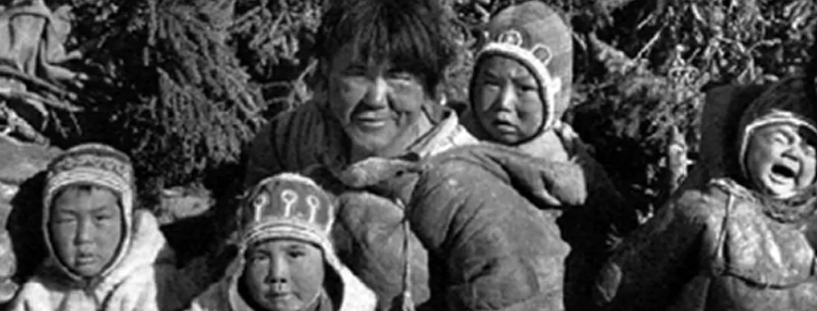 A family of Ahiarmiut, including David Serkoak pictured behind his mother Mary Qahug Miki (centre) at Ennadai Lake in the mid-50s before the Canadian government forcefully relocation them.