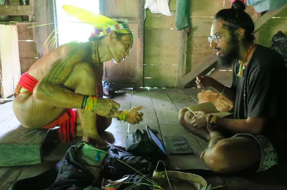 As part of his anthropological fieldwork, author Manvir Singh speaks with an Indonesian shaman. Luke Glowacki,  CC BY-ND
