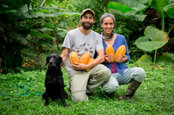 Alejandro and Agostina, conservationists and owners of Ecuadorian Mashpi Artisanal Chocolate Farm educate Purposeful Nomad travelers about sustainable farming while sharing their award-winning handcrafted Arriba Cocoa bars. Jessica Scranton. Purposeful Nomad.