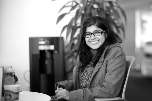 Khalida Brohi sitting at a table, smiling. Joi Ito. CC 2.0