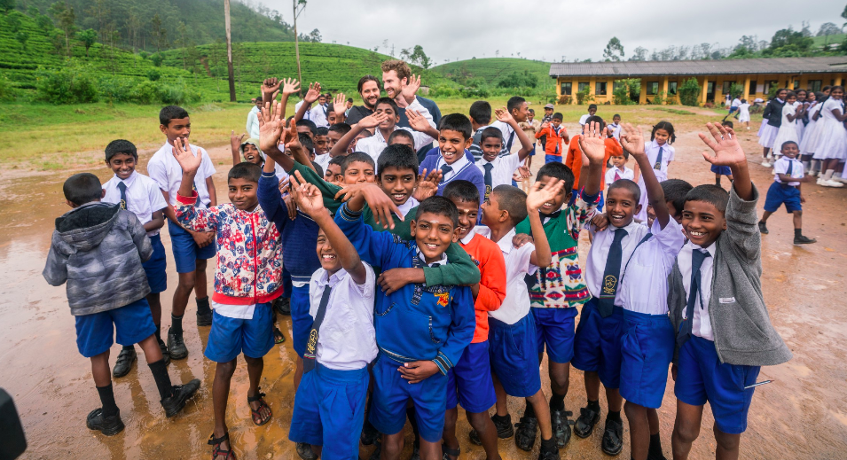 Schoolyard antics in Sri Lanka with Matt Moreau and Kori Chilibeck of The Earth Group.