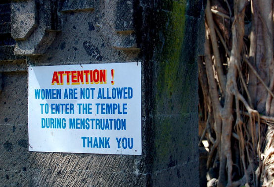 A sign in Bali, Indonesia, demonstrates stigmatization of menstruation in the Global South. dominique bergeron. CC BY-NC-ND 2.0