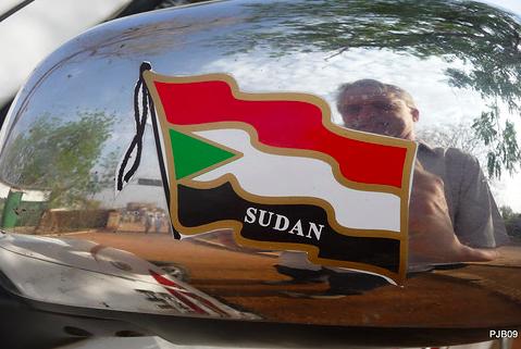 Sudan Flag Sticker on a Car. pjbury. CC BY-NC-ND 2.0