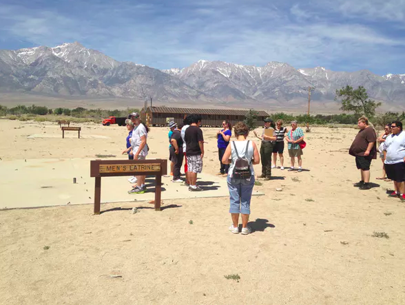 Young tourists experience the humiliating lack of privacy at Manzanar National Historic Site. Jennifer Ladino,  CC BY-ND