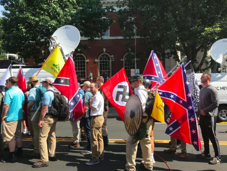 White supremacists gathered for the Unite the Right rally in Charlottesville, Virginia. By Anthony Crider. CC by 2.0.