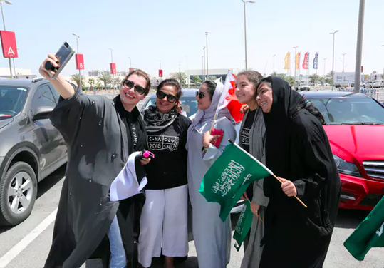 Women celebrate the end of Saudi Arabia's ban on women drivers, July 24, 2018.  Reuters/Hamad I Mohammed