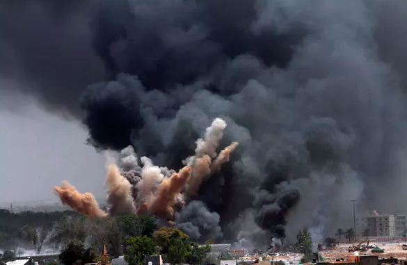 Targeting Gadaffi: NATO bombs hit the Libyan leader's compound in June 2011. EPA