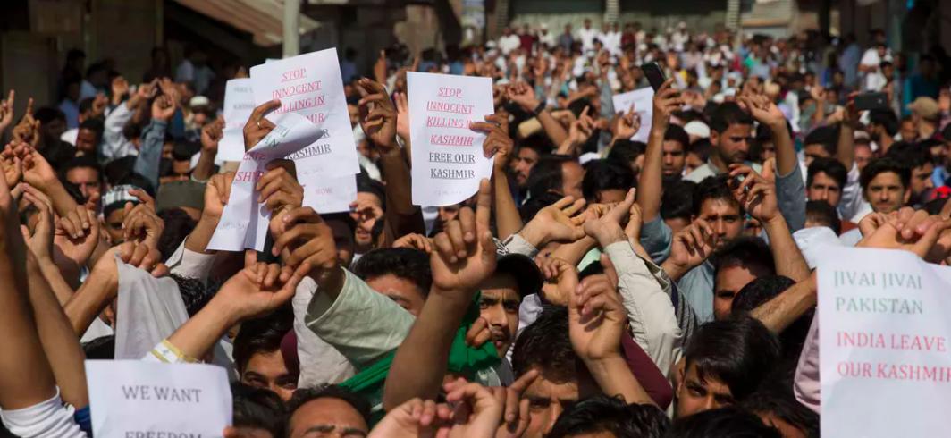 Kashmiri Muslims shout slogans during a protest after Eid prayers in Srinagar.  AP Photo/ Dar Yasin