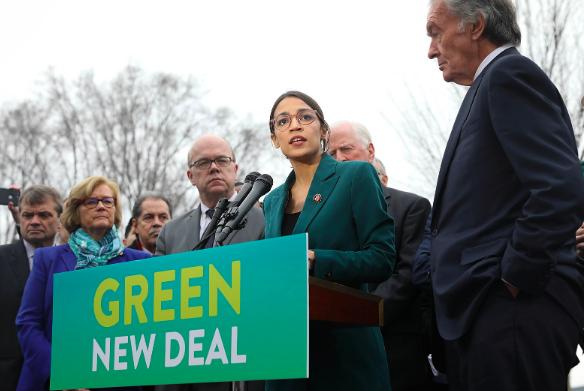 Representative Alexandra Ocasio-Cortez speaks on the Green New Deal with Senator Edward Markey. Senate Democrats via Wikimedia Commons. CC BY 2.0