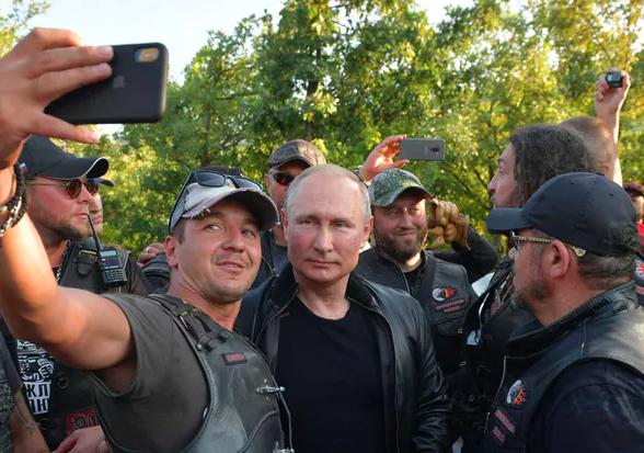 Russian influence: Vladimir Putin with members of the pro-Kremlin biker gang Night Wolves in Sevastopol, Crimea, August 2019. EPA-EFE/Alexei Druzhinin/Sputnik/Kremlin