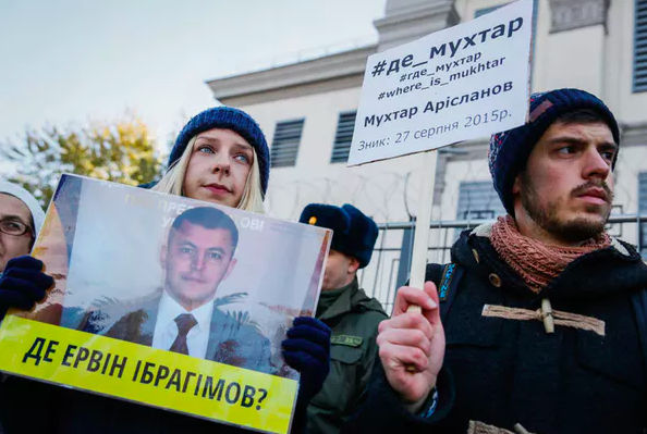 Protesters demonstrate against the disappearance of Crimean Tatar activists. Tatars are one of Ukraine's oppressed minority groups, October 2016. EPA/Roman Pilipey