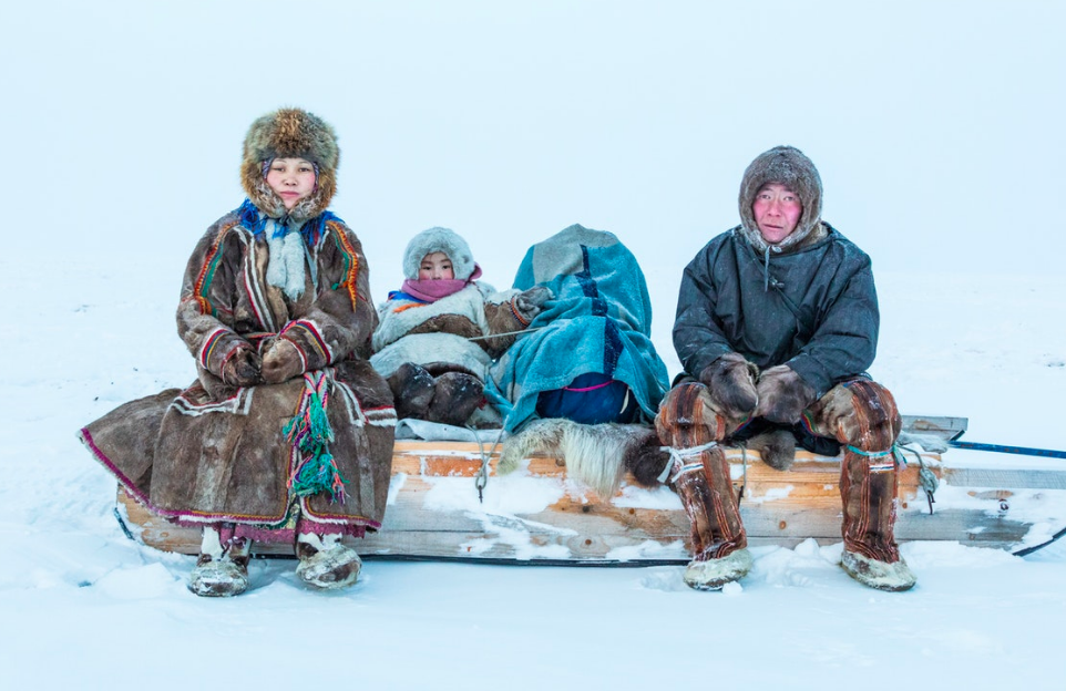 Khudi family portrait. Left to right: Lena, her 4-year-old daughter, Christina, under blankets in the baby cradle, her newborn son, Phillip, and her husband, Leonya. Not pictured, the couple's 9-year-old son, Ephim, who is currently attending the village boarding school.