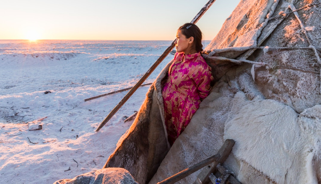 Lena's domestic responsibilities are crucial to support her family given the extreme environment. She must coordinate with the hospital helicopter service for pick up in advance of going into labor, but not too early as her ongoing presence out on the tundra is essential. / prints available