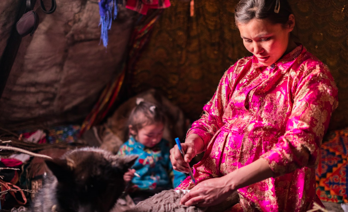 Lena fills her free time with making clothes for her family. Each item of a Nenets' winter costume is taken from a specific part of the reindeer. For example, the hides used for boots are cultivated in middle of the winter to ensure the thickest fur.