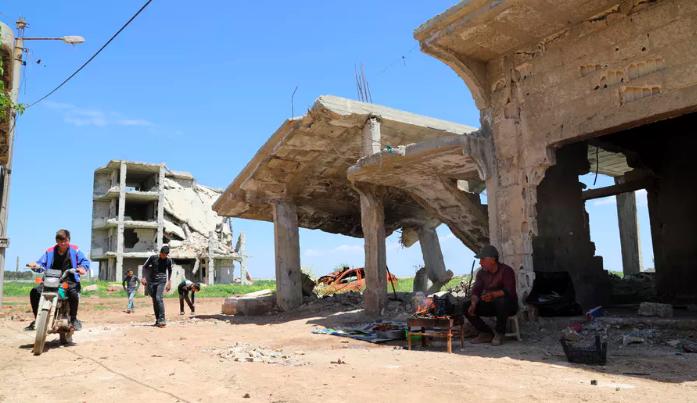 Life on the border: Kurdish men in Kobani, Syria. Ahmed Mardnli/EPA