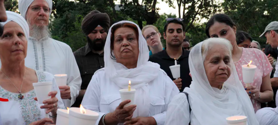People participate in a candlelight vigil near the White House to protest violence against Sikhs in 2012.  AP Photo/Susan Walsh