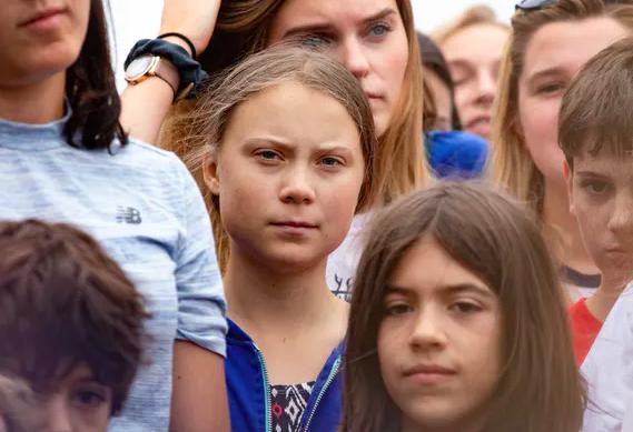 Thunberg at a school strike in Washington, DC.  Aschwaphoto/Shutterstock.