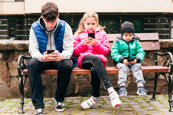 A phone can be a lifeline for unaccompanied minors.  Shutterstock/Marian Fil