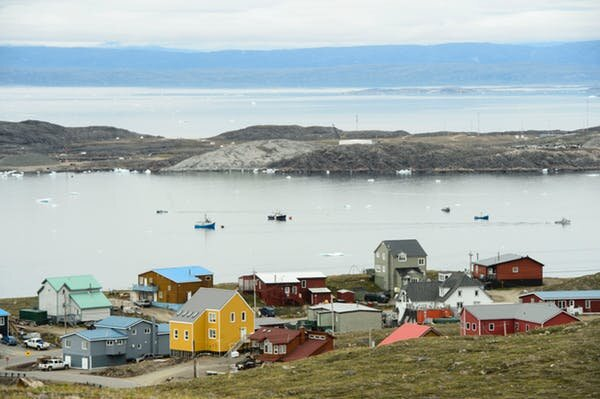 Small boats make their way through the Frobisher Bay inlet in Iqaluit on Aug. 2, 2019. THE CANADIAN PRESS/Sean Kilpatrick