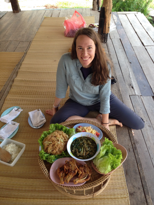 Kimberly with some of our favorite Isaan food (Isaan is the name for the culture/region in our northeast part of Thailand. Sticky rice, spicy papaya salad, fried chicken, and fried noodles... Yum!