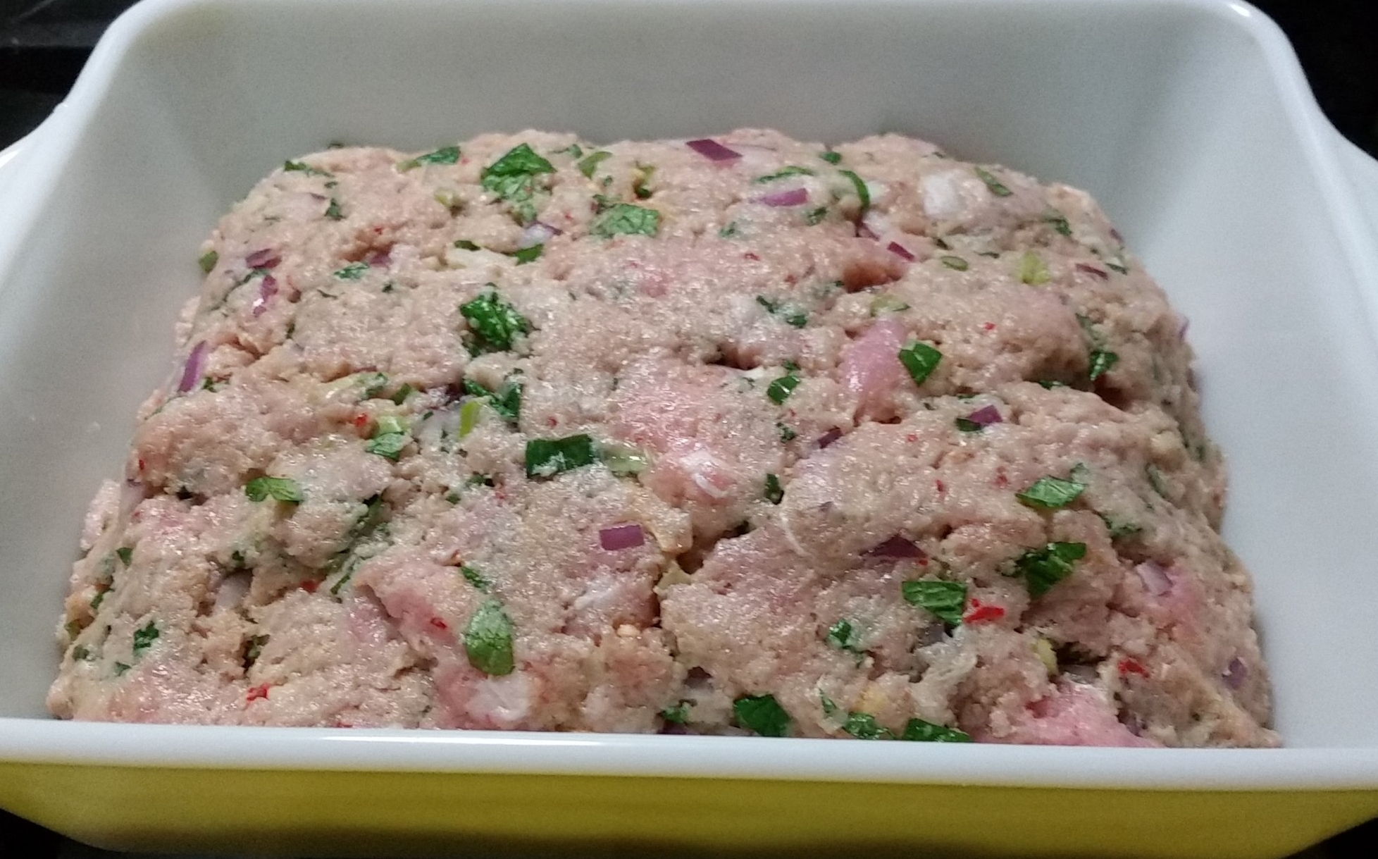 This is a raw meatloaf. Imagine it's cooked.  Enjoy.
