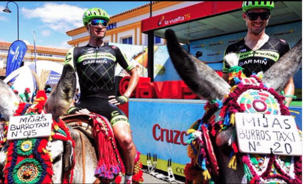Alex Howes is a caballero. Some burros at rider sign in before the stage.