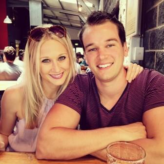 Aussie Brad Russell with his two loves: his girlfriend and his beer. Source: Brad Russell