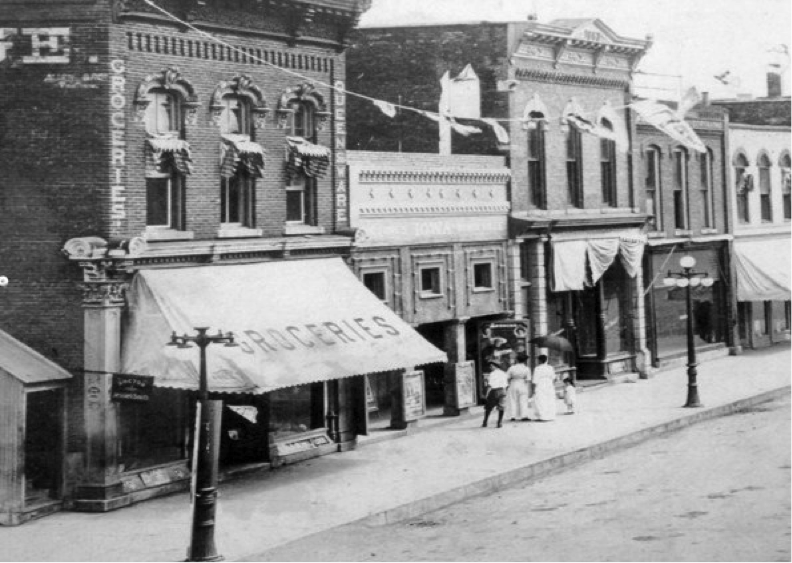 Photo of 121 John Wayne Drive (known historically as First Street) in the early 1900s. Originally built as a grocery store, this photo shows the building's facade after it had been converted to a vaudeville theatre.  Photo provided by the Madison County Historical Society.