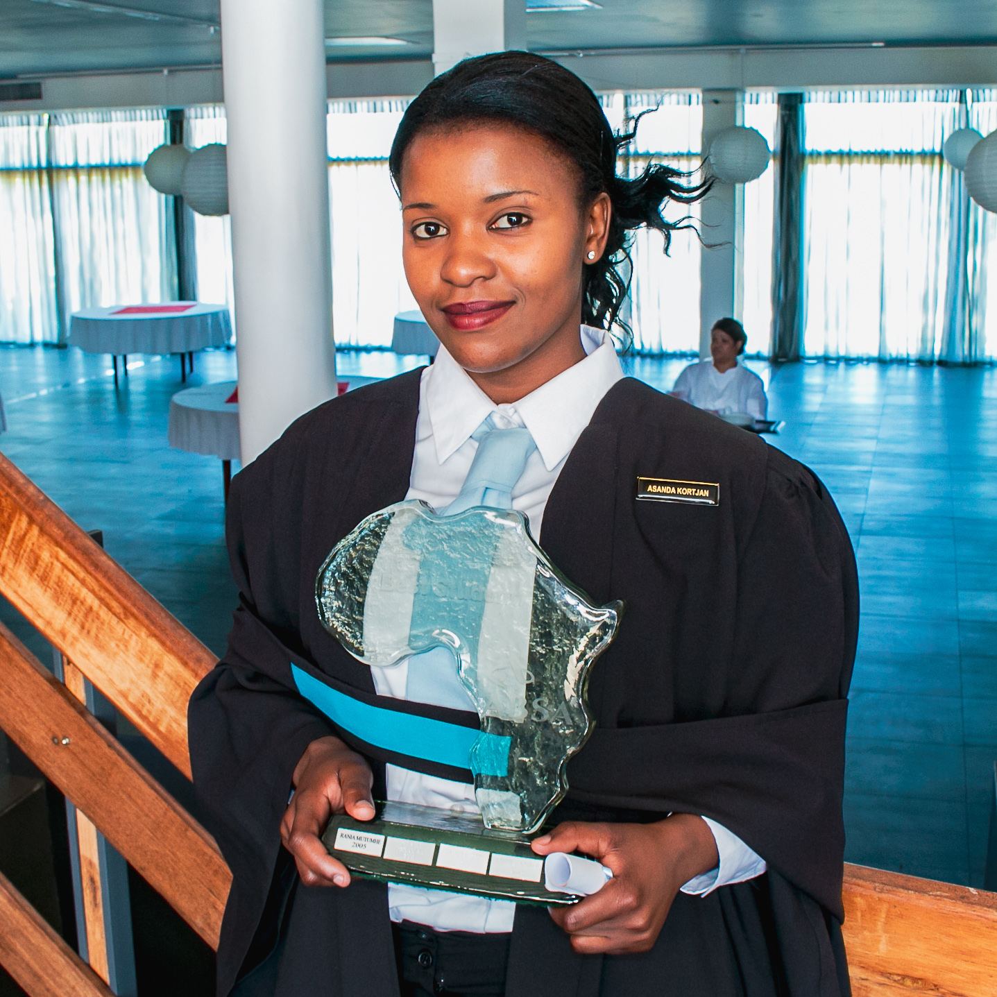 Asanda with her award for finishing #1 in her class at the SA College for Tourism