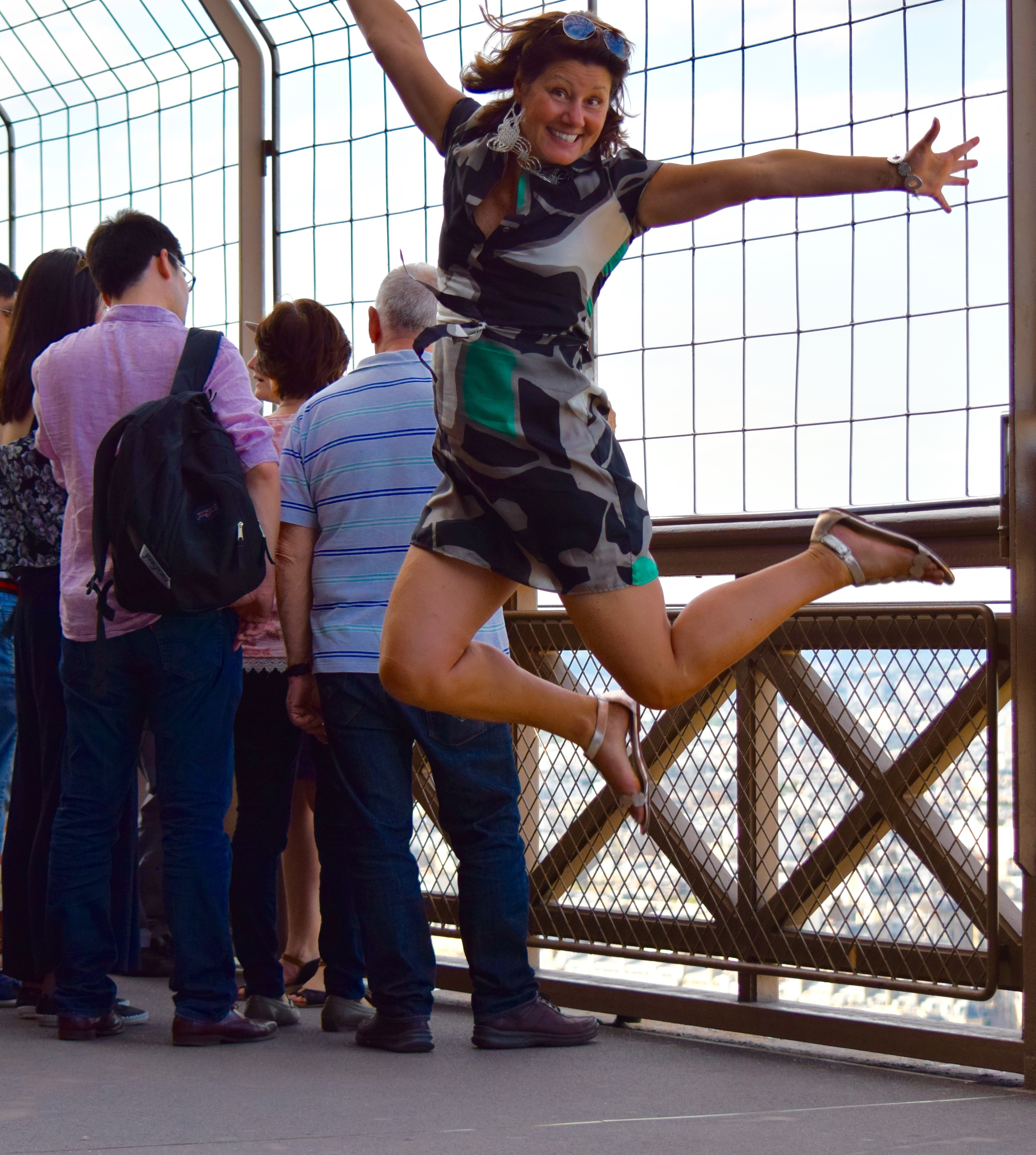 Anita Grace feeling joy at the top of the Eiffel tower. The picture was taken by her 16-year-old son.