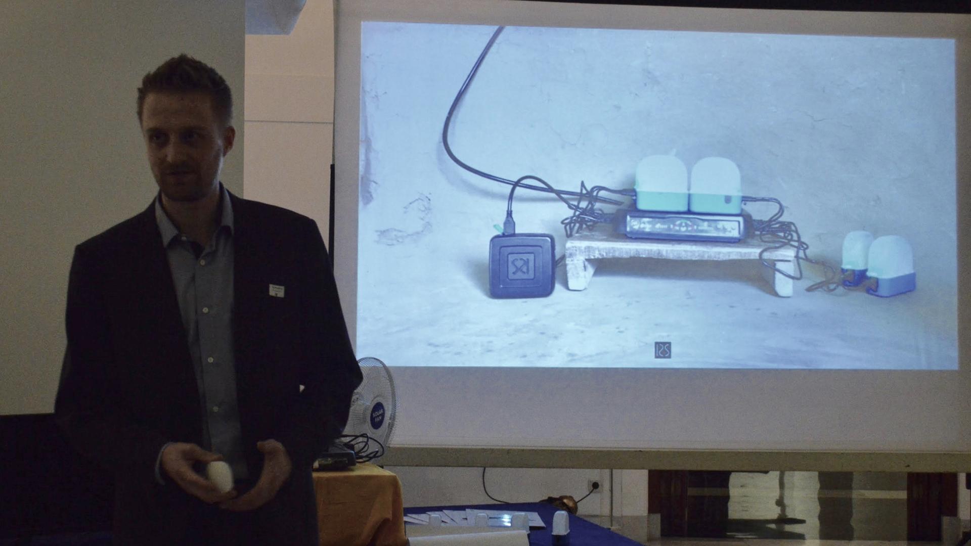 Evan Mertens, co-founder of Rural Spark, showing the new Rural Spark Energy Kit.