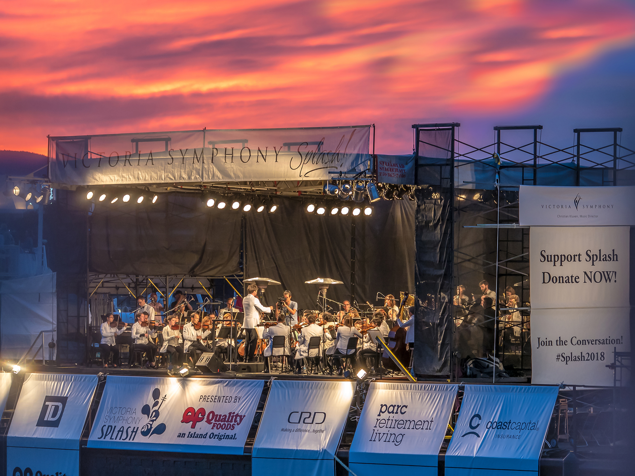 """What a beautiful evening it was for this event, thousands of people gathered at the Inner Harbour to listen to the music, the weather was hot and the sunset was magic. More photos can be seen on the """"Events"""" page."""