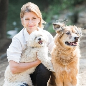 Dr. Whitlock with her dogs Sam & Scout
