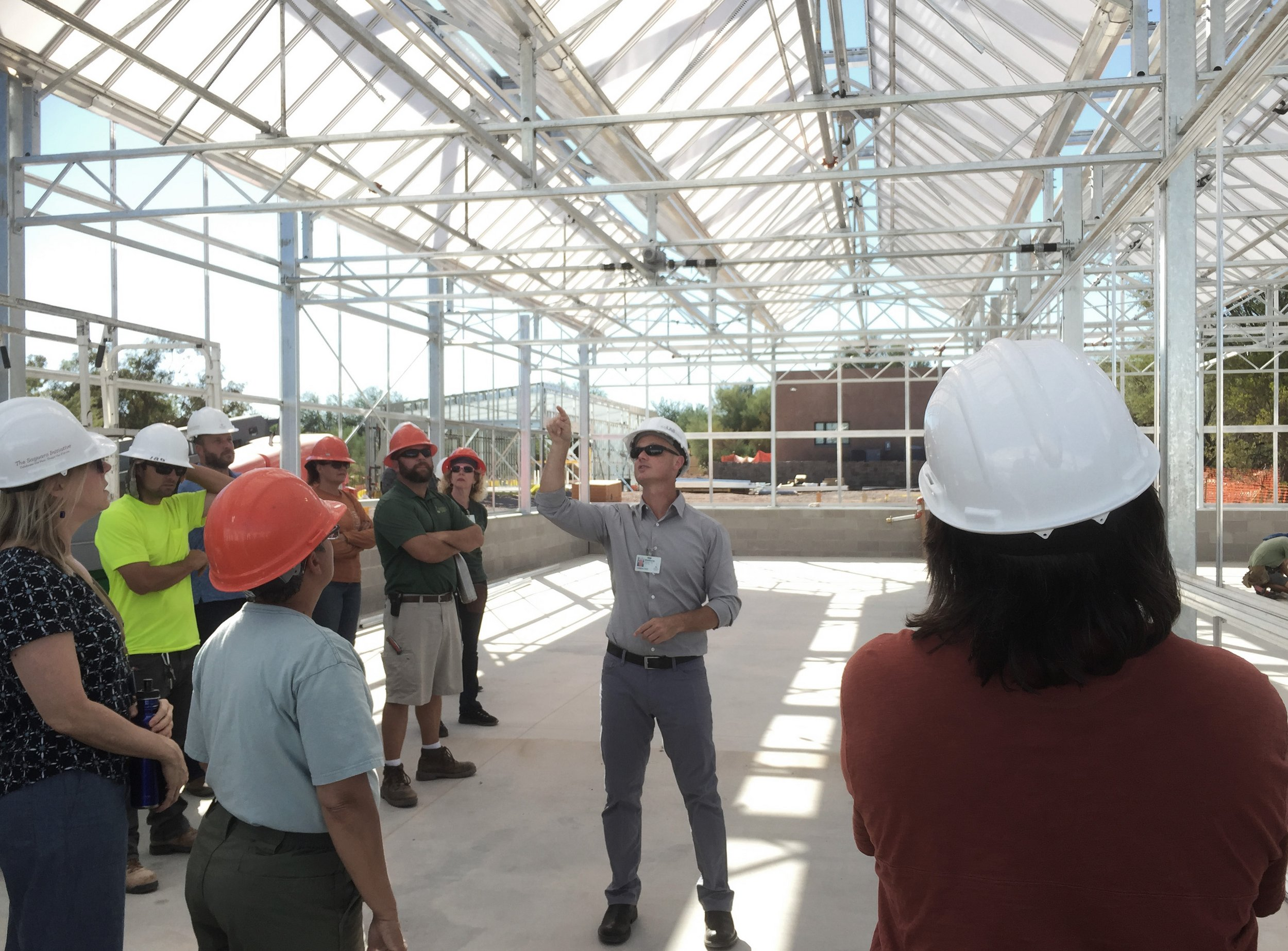 Matthew Salenger of coLAB studio leads a tour of the site, culminating at the new Greenhouse building.