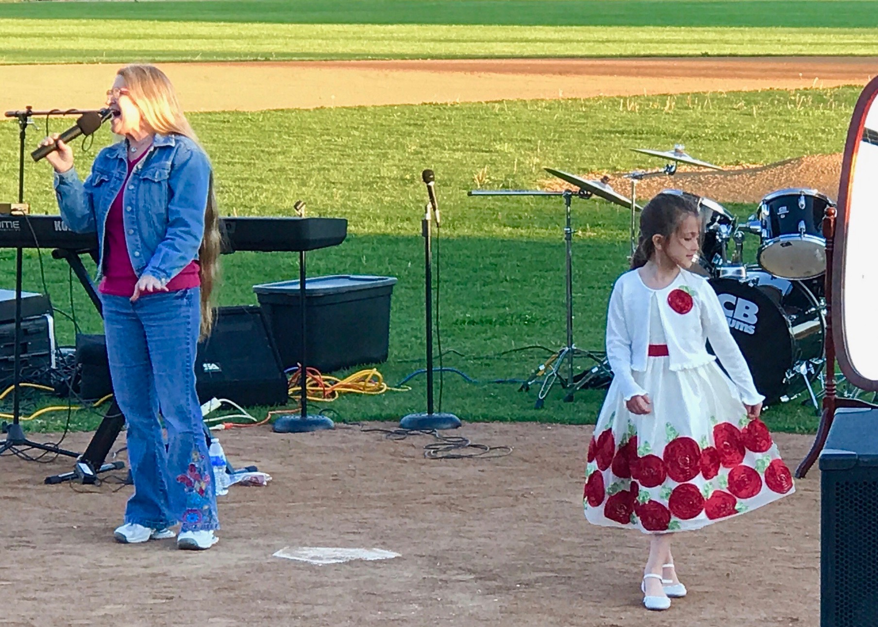 "Poppy sang the song ""Priceless"" by For King and Country.  My daughter Rayna had a white dress on and danced along.  This was such a beautiful time declaring God's love over the crowd!"