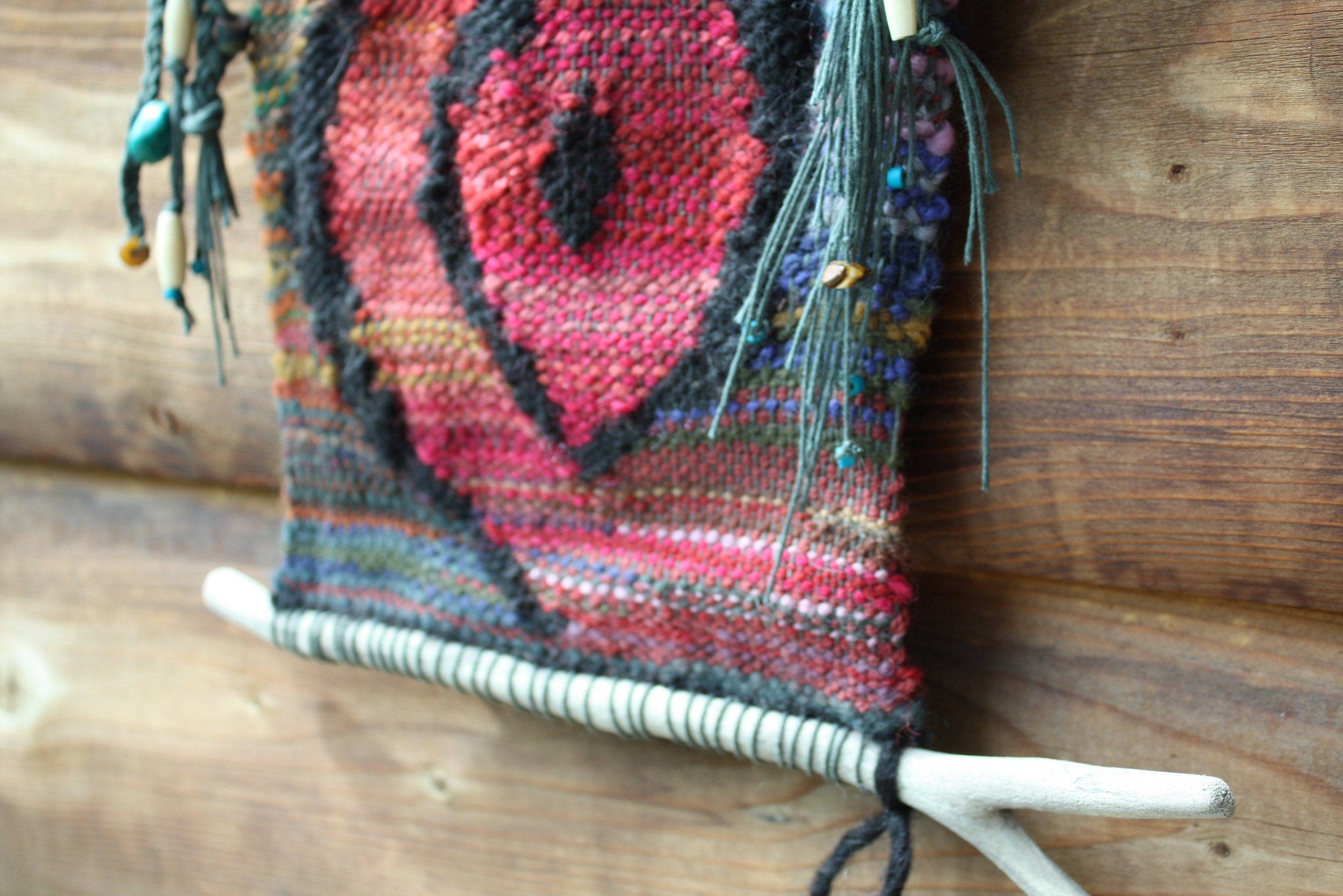 """River driftwood mounting for """"Wombsight"""" a tapestry handwoven by 14 Mile Farm"""