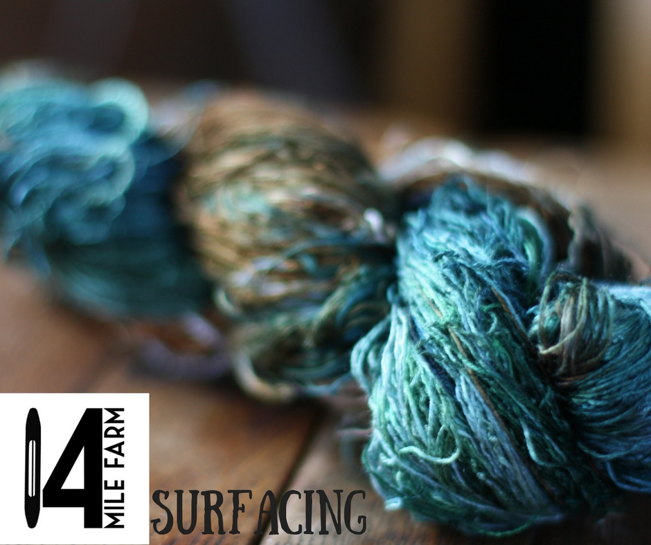 Skein of hand dyed yarn in tones of teal, aqua, and mossy greens and browns | 14 Mile Farm Handweaving and Homesteading