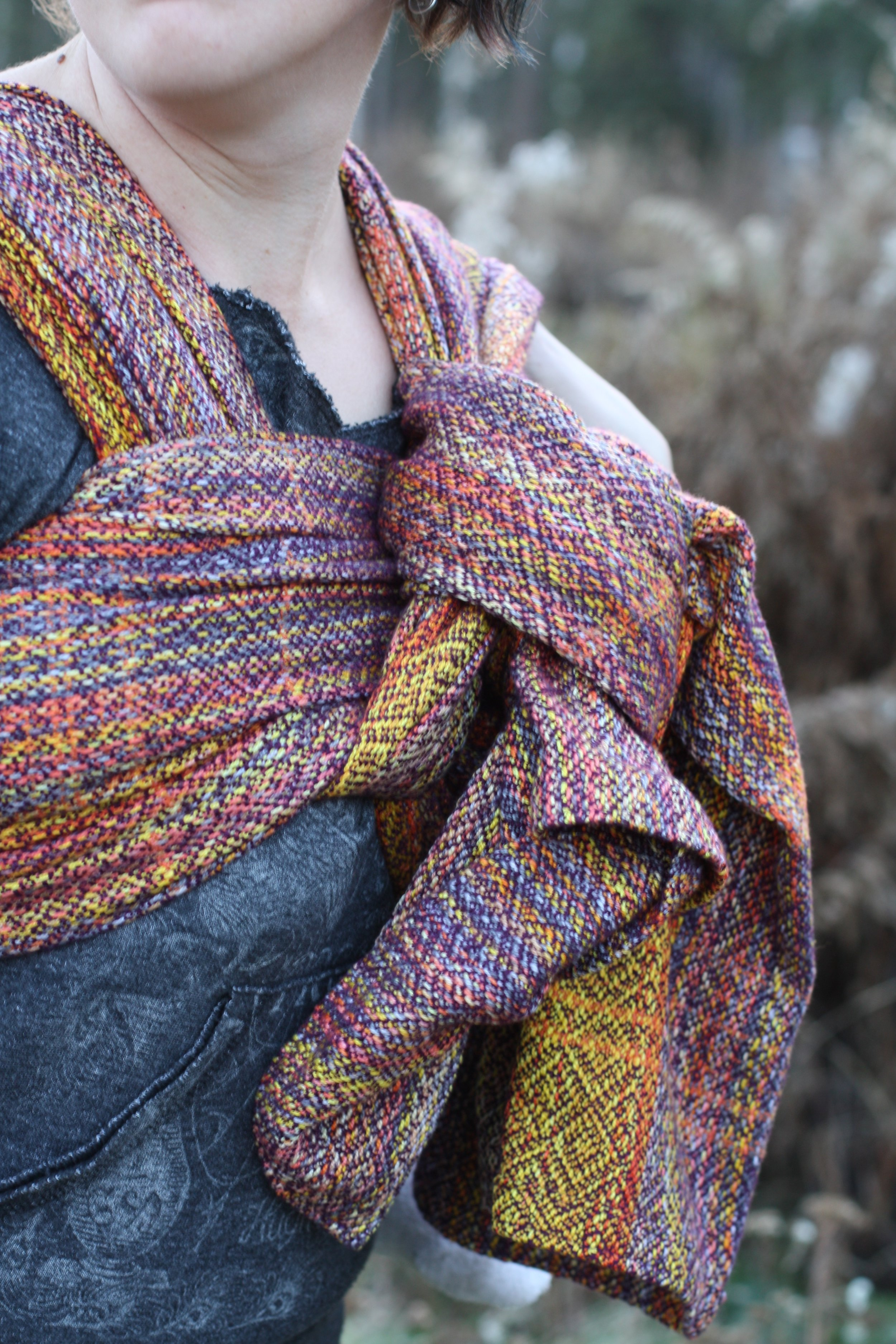 Snowbirding, an autumnal sunset handwoven baby wrap with purple tencel weft | 14 Mile Farm Handweaving and Homesteading