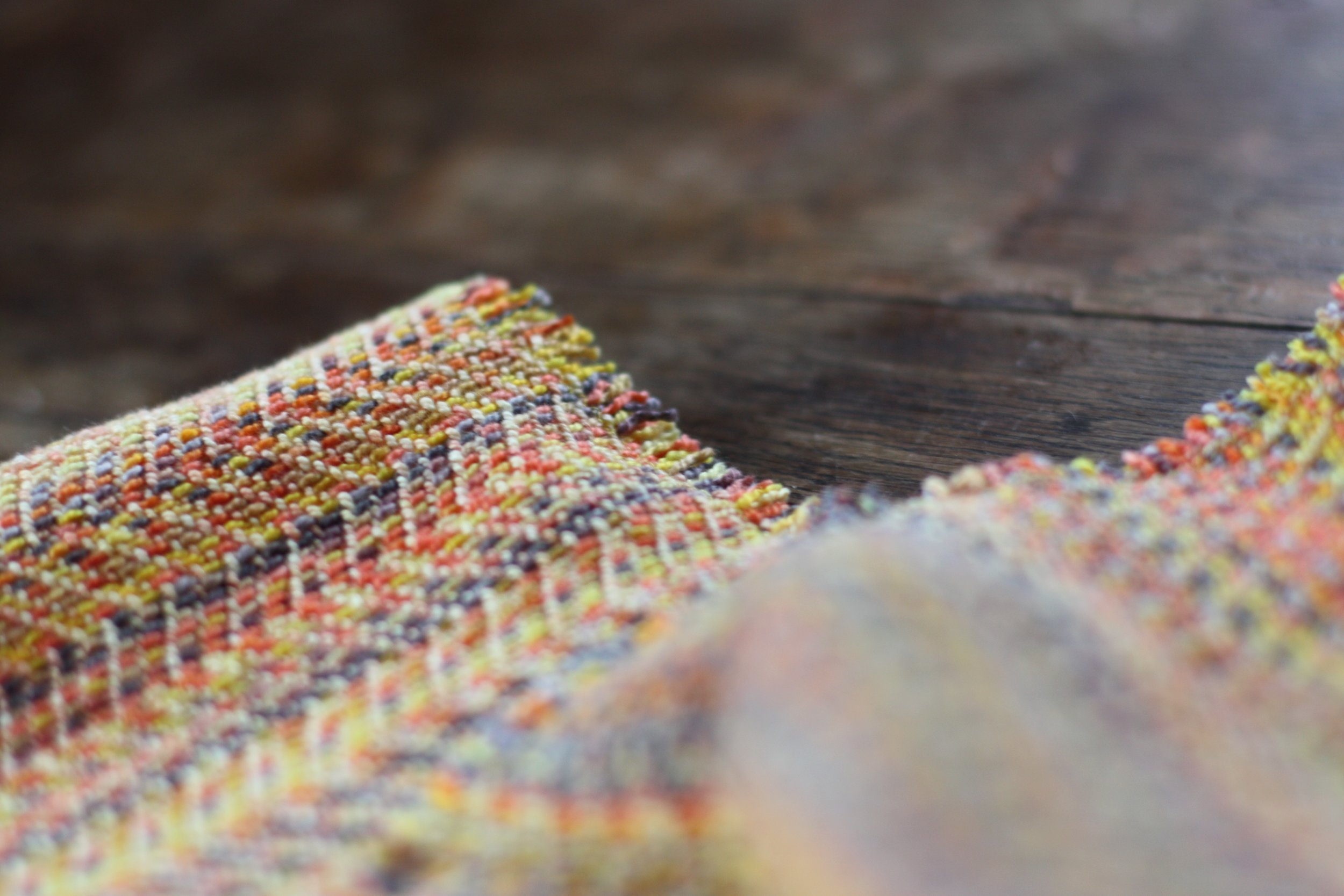 Snowbirding, an autumnal sunset handwoven cowl with hand dyed weft| 14 Mile Farm Handweaving and Homesteading
