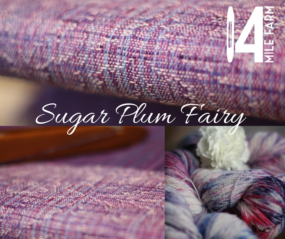 Sugar Plum Fairy features a lacy advancing twill faux crackle weave that is reminiscent of frost on winter window panes.  This piece features a merino silk sparkle weft splatter painted in purple, pink, and blue. Handwoven baby wrap | 14 Mile Farm Handweaving and Homesteading in Alaska