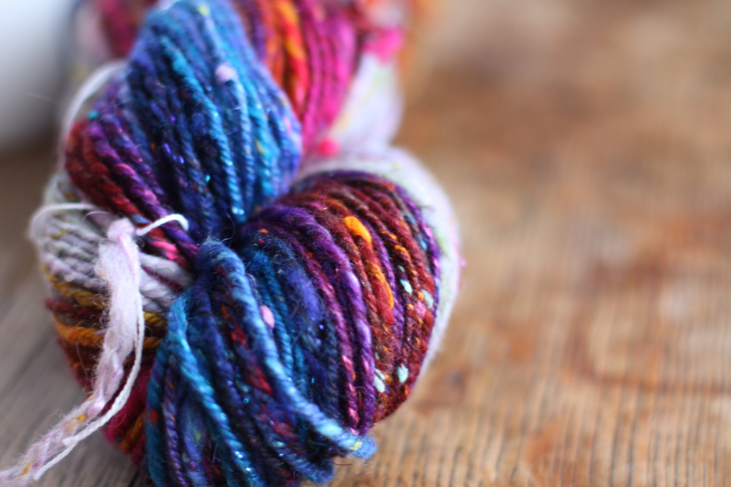 Handspun textured yarn in jewel tones from Inglenook's 12 Days of Christmas spinalong