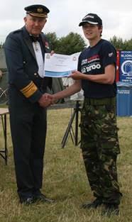 Cpl McClune receiving his award