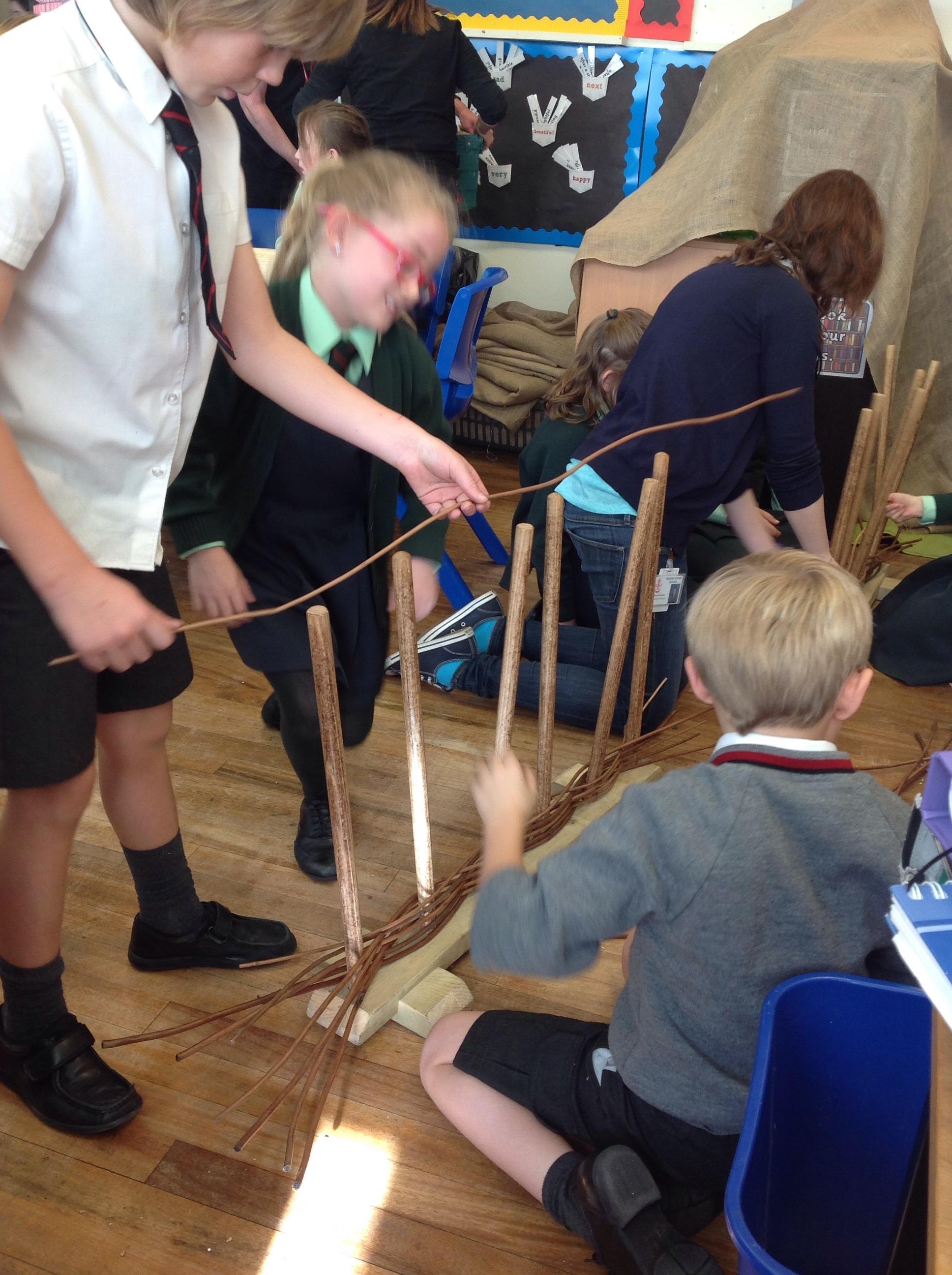 Weaving sticks to build fences.