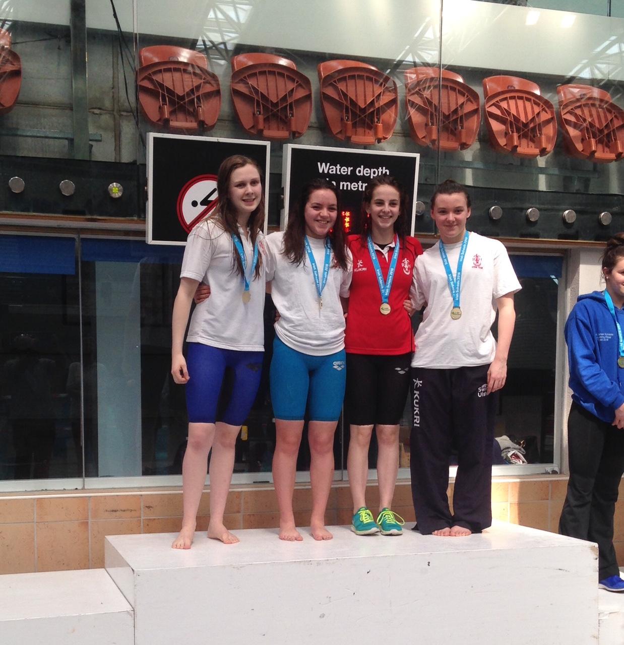 The Senior Girls Relay Team receiving their medals.jpg