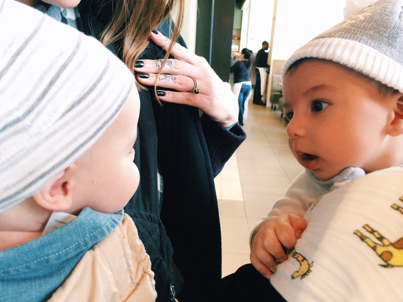 Babies meeting babies, aka the cutest thing ever.