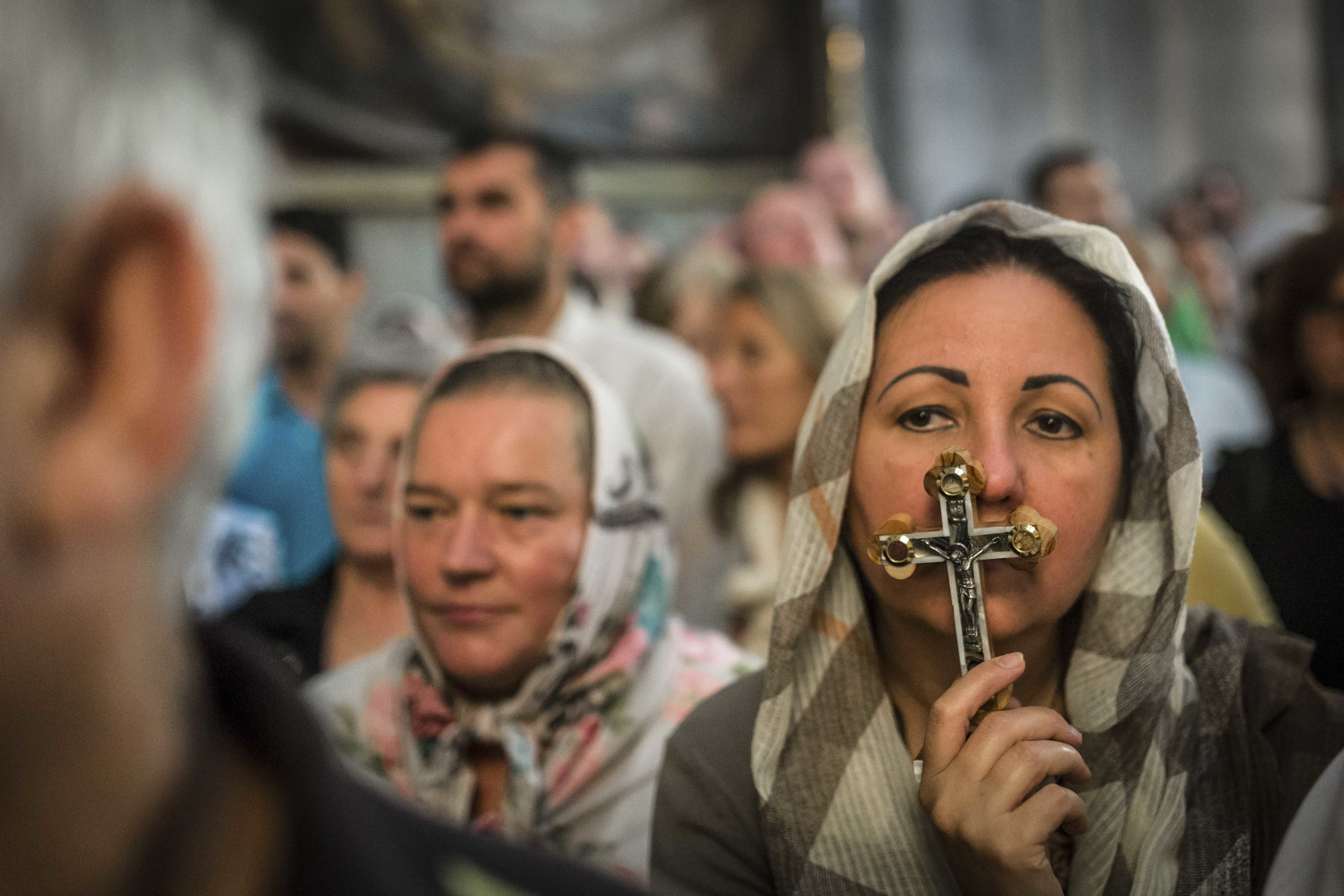 A christian worshipper prays in the Church of the Holy Sepulchre at the ceremony of the Holy Cross in Jerusalem's Old City.