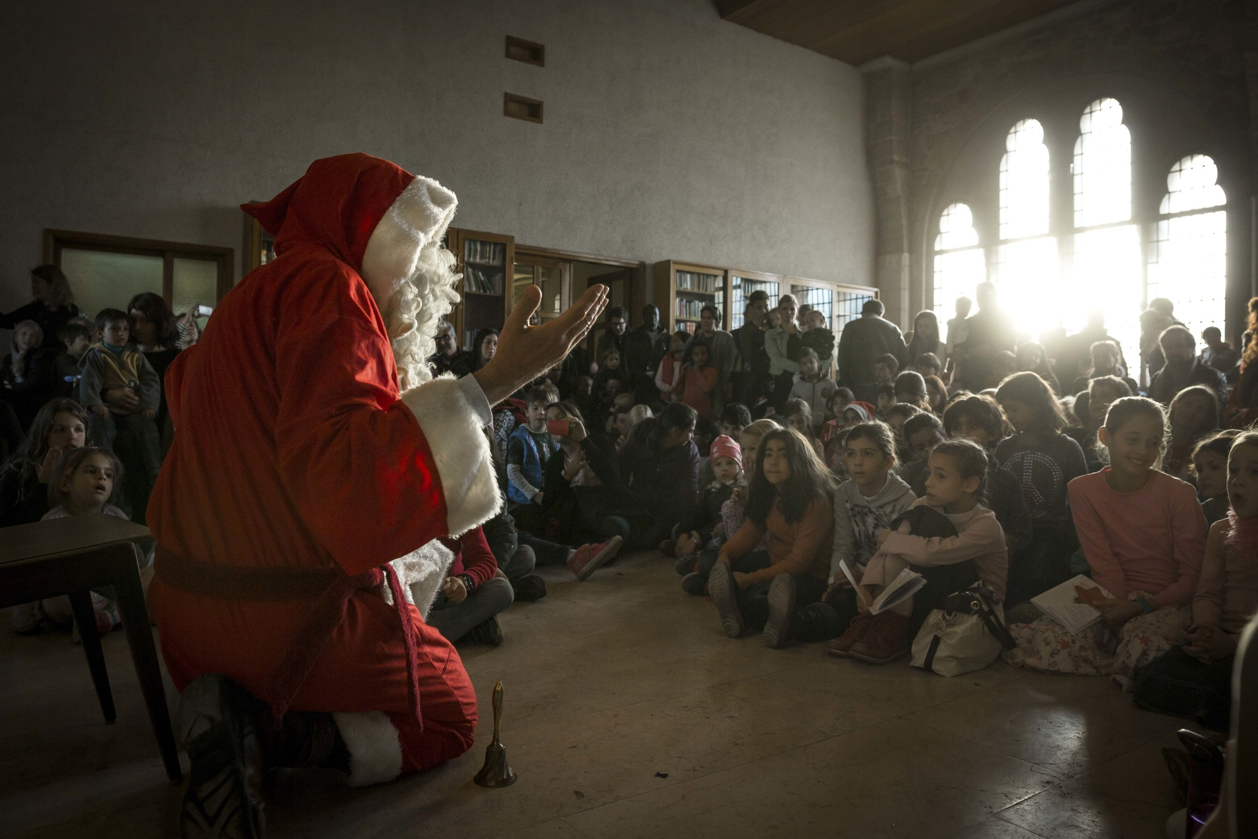 Propst Wolfgang Schmidt performs a pre Saint Nicolaus day in front of young children in the Church of the Redeemer in Jerusalem's Old City.